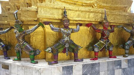 colorful mosaic statues at the temple of the emerald buddha in bangkok
