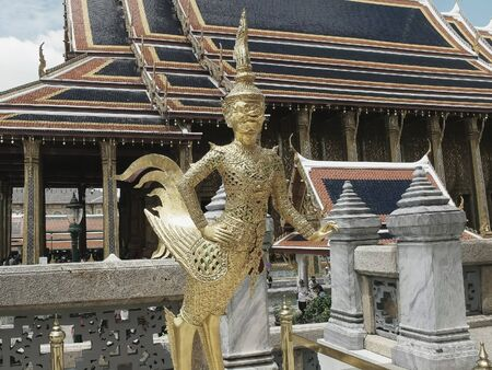 angel statue at the emerald buddha temple in bangkok