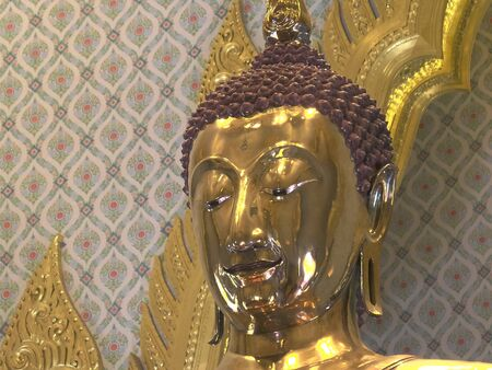 close shot of the head of a solid gold buddha statue at wat traimit temple