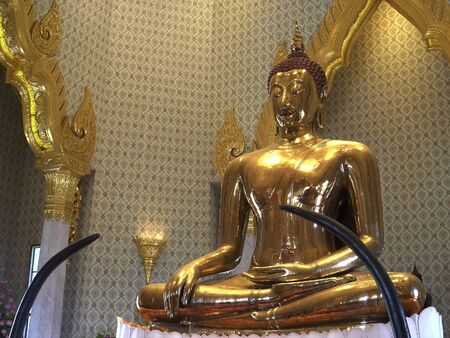 oblique view of a golden buddha at wat traimit temple in bangkok, thailand