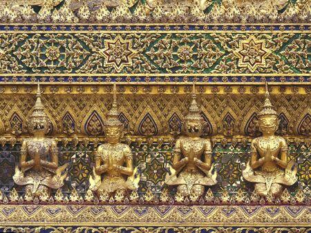 guardian demon statues on phra mondop at the emerald buddha temple, bangkok