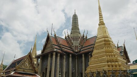 several buildings in the emerald buddha temple complex at bangkok Stock Photo