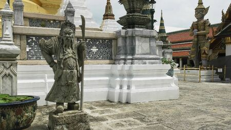 stone chinese guard statue at the emerald buddha temple in thailand