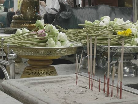 lotus flowers and incense at the emerald buddha temple in bangkok