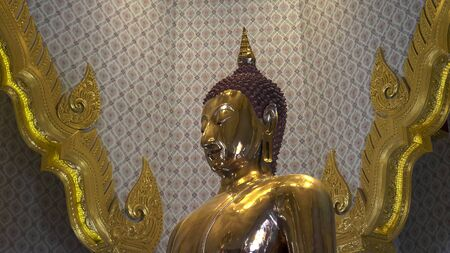close up side on shot of the golden buddha in bangkok