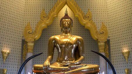 front shot of the gold buddha at wat traimit in bangkok 写真素材