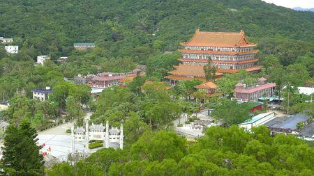 wide high angle shot of po lin monastery at tan tian in hong kong