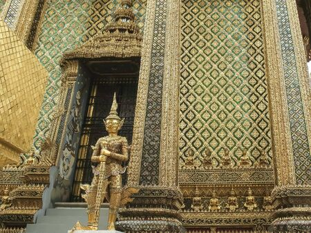 gilded statue at the emerald buddha temple in thailand Stock Photo