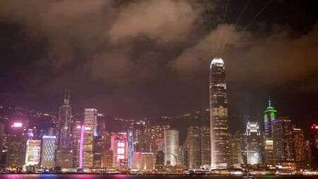 laser show at victoria harbour and the ifc building in hong kong