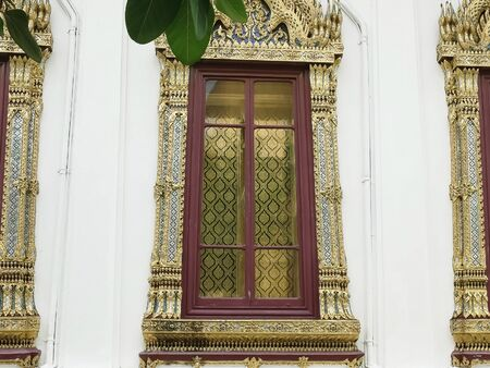 close up of three windows at the emerald buddha temple in thailand Stock Photo