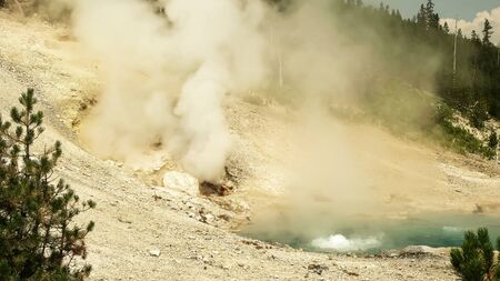 beryl spring and a steam vent at yellowstone Stock Photo