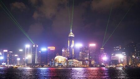 a laser light show at victoria harbour and hong kong island- as viewed from tsim sha tsui promenade in hong kong, china Stock fotó