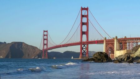 close view of golden gate bridge from marshalls beach in san francisco