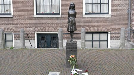 AMSTERDAM, NETHERLANDS-OCTOBER, 12, 2017: anne frank statue in amsterdam