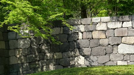 an ancient stone wall at the imperial palace in tokyo