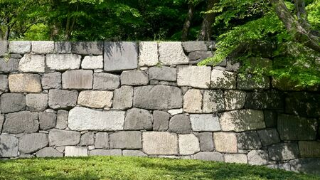 an ancient stone wall at the imperial palace in tokyo Archivio Fotografico