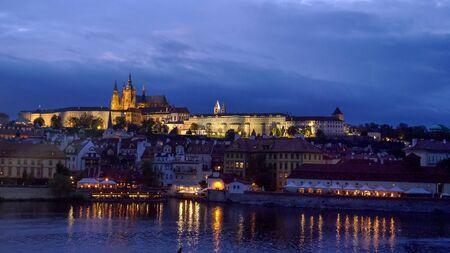 night shot of prague castle and the vltava river in prague
