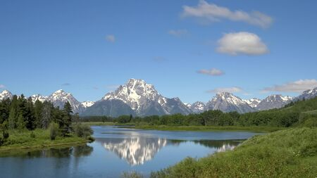 morning shot of the tetons at oxbow bend in wyoming