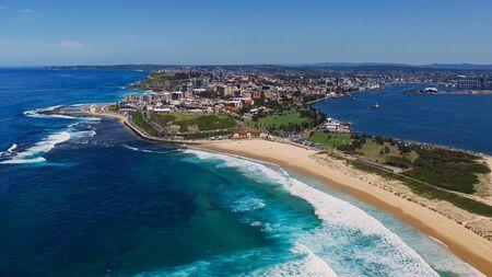drone aerial shot of newcastles nobbys beach