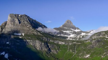 wide morning view of mt clements and reynolds mtn in glacier national park