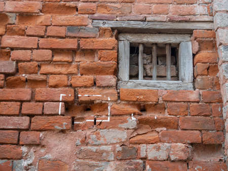 window and bullet marks on a wall at jallianwala bagh massacre site in amritsar
