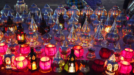 night shot of small lanterns with candles at a market in marrakech