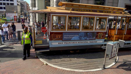 SAN FRANCISCO, CA, USA- FEBRUARY, 17, 2020: workers push a cable car off the powell street turntable