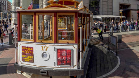 SAN FRANCISCO, CA, USA- FEBRUARY, 17, 2020: workers rotate a cable car on a historic turntable