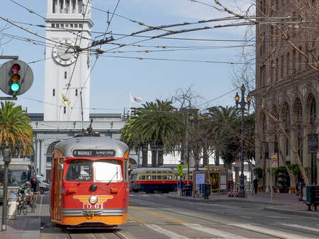 SAN FRANCISCO, CA, USA- FEBRUARY, 17, 2020: close up of a street car with the san francisco ferry building in the background