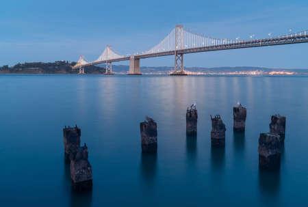 long exposure dusk shot of the san francisco oakland bay bridge at san francisco