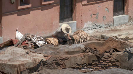 high shot of a tannery worker at marrakesh