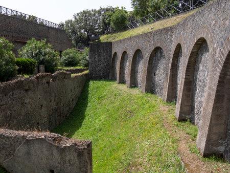 NAPLES, ITALY- JUNE, 13, 2019: ancient roman stone wall at pompeii ruins
