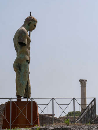 NAPLES, ITALY- JUNE, 13, 2019: modern art bronze statue of a soldier with a spear by igor mitoraj at pompeii ruins