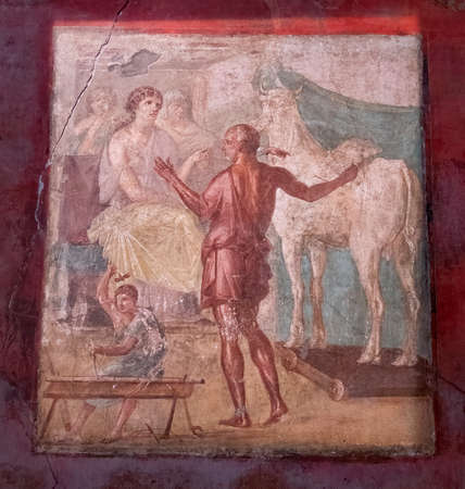 NAPLES, ITALY- JUNE, 13, 2019: NAPLES, ITALY- JUNE, 13, 2019: fresco painting of daedalus and pasiphae in the house of the vettii in pompeii