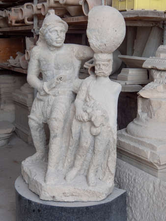NAPLES, ITALY- JUNE, 13, 2019: stone gladiator statue at pompeii ruins