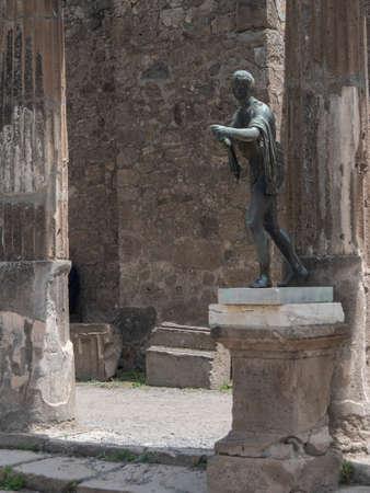 NAPLES, ITALY- JUNE, 13, 2019: bronze statue of apollo the archer in the temple of apollo at pompeii