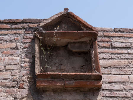 NAPLES, ITALY- JUNE, 13, 2019: low angle shot of a window of ruined building at pompeii