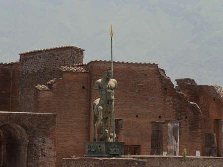 NAPLES, ITALY- JUNE, 13, 2019: front view of a modern art bronze statue of a centaur at pompeii