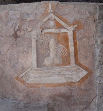 NAPLES, ITALY- JUNE, 13, 2019: close up of a phallic symbol on the wall of a house at pompeii