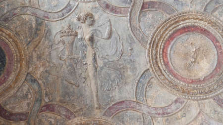 NAPLES, ITALY- JUNE, 13, 2019: a bas relief of a woman at pompeii 新闻类图片
