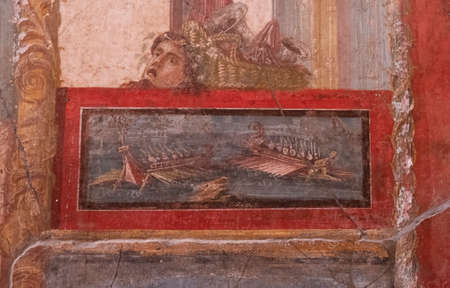 NAPLES, ITALY- JUNE, 13, 2019: NAPLES, ITALY- JUNE, 13, 2019: fresco painting of galley ships from the house of the vettii in pompeii