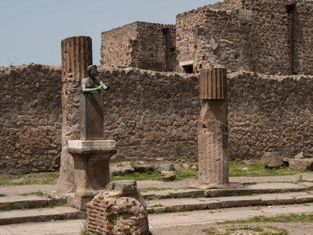 NAPLES, ITALY- JUNE, 13, 2019: replica bronze diana statue in ruins of temple of apollo at pompeii
