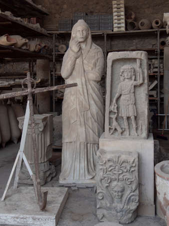 NAPLES, ITALY- JUNE, 13, 2019: statues and artifacts discovered at the ruin st the ancient roman city of pompeii