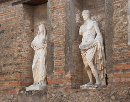 NAPLES, ITALY- JUNE, 13, 2019: two marble statues at pompeii ruins