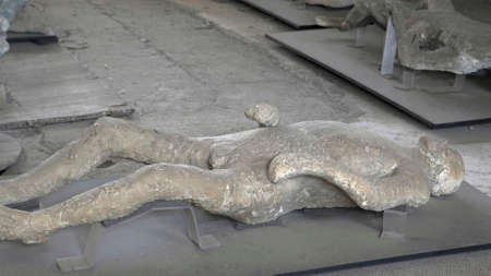 NAPLES, ITALY- JUNE, 13, 2019: plaster cast of a victim of the eruption at pompeii