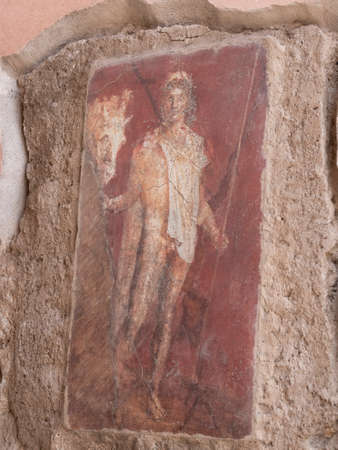 NAPLES, ITALY- JUNE, 13, 2019: fresco painting of a man holding a horse, by its bridle, on a house wall at pompeii