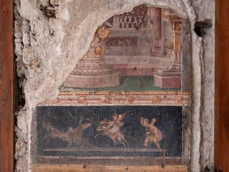 NAPLES, ITALY- JUNE, 13, 2019: fresco painting of a mythological scene on a house wall at pompeii