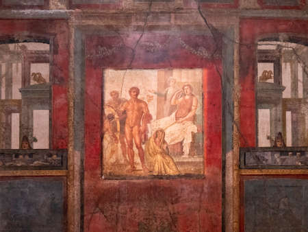 NAPLES, ITALY- JUNE, 13, 2019: NAPLES, ITALY- JUNE, 13, 2019: fresco painting of the punishment of ixion in the house of the vettii in pompeii
