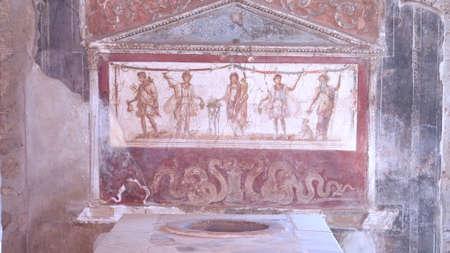 NAPLES, ITALY- JUNE, 13, 2019: painted lararium of five figures in the thermopolium of vetutius placidus at pompeii