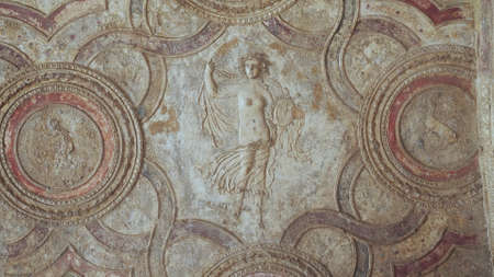 NAPLES, ITALY- JUNE, 13, 2019: bas-relief of a woman on a bath house ceiling in pompeii 新闻类图片